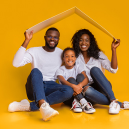 Happy family with roof insurance claim
